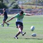 New Highlanders first five-eighth Josh Ioane practices his kicking at Logan Park yesterday. Photo...