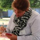 Strath Taieri Young Farmers Club member Elizabeth Graham, of Hindon, considers her scoring during...