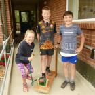 Meg Howard shows off her boot cleaner with Ben Cairns (centre) and Alfie Cowie (all 10). Photos:...