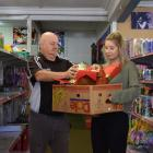 Mosgiel $2 & More co-owner Phil Tate, of Abbotsford, and shop assistant Cherish Thom, of...