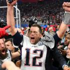 New England Patriots quarterback Tom Brady reacts after winning the Super Bowl LIII against the...