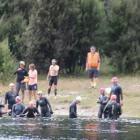 IMG 3859: Swimmers entering the water in the Upper Waiau River at the Control Gates in Te Anau...