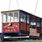 Dunedin Heritage Light Rail Trust spokesman Neville Jemmett as restored cable car Roslyn No 95 is lifted into place at the trust's Mornington shed.Photo: Peter McIntosh