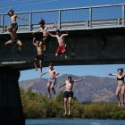 A group of Mount Aspiring College pupils jump off the Albert Town Bridge yesterday in defiance of...