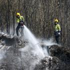 Firemen try to cool down smouldering land at Walters Bluff in the Tasman District. Photo: Getty...
