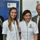 Australian father James McBrayer (left) passes on the family tradition to daughter Charlotte,...