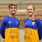 University of Otago Football Club players Oban Hawkins and Erin Roxburgh show off the 150th...