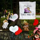 Flowers and signs are seen at a memorial site for victims of the mosque shootings, at the Botanic...