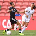 Abby Erceg passes the ball under pressure from Soledad Jaimes during the Football Ferns' match...