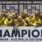 The Australian team celebrate with the trophy after winning the one day international series...