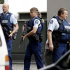 Armed police patrol in central Christchurch after the shooting. Photo: AP