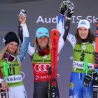 Second-placed Alice Robinson (L) on the podium with winner Mikaela Shiffrin (C) and third-placed...