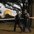 Police officers patrol at a park outside the Al Noor mosque in Christchurch this week. Photo: AP