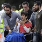 Zaed Mustafa, who was injured in the attacks, reacts during the burial of his father Khalid and...