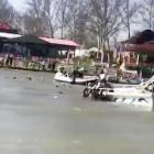 Rescue efforts under way in the Tigris River after the ferry sank, in this image taken from video...