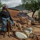 A woman who lost her daughter-in-law and three grandchildren to Cyclone Idai-induced rains stands...