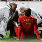 Cristiano Ronaldo receives treatment from medical staff during Portugal's match against Serbia at...