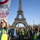Protesters rally in Paris to support another activist injured in a confrontation with police last...