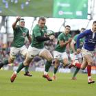 Ireland's Keith Earls breaks through to score a try against France during their Six Nations rugby...