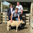 Michael Robinson holds the Beltex ram lamb for which he and his parents Ann-Maree and Brent paid ...
