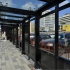 Glass shelters and new footpaths have been installed as  construction of Dunedin's bus hub winds...