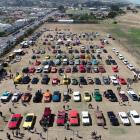 American cars, including Fords, Chevrolets, Mustangs, Dodges and Plymouths, were on display at...