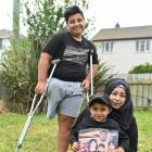 Pine Hill former refugees Nisrine (36), Kasem (14) and Mohammad (5) Zarzar in their garden after...