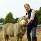 Georgie Wallace, of Tasmania, with the supreme champion sheep at the Wanaka A&P Show, a...