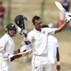 Jeet Raval acknowledges the crowd after scoring his maiden test century against Bangladesh in...