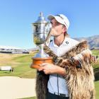 Zach Murray, of Australia, kisses the Brodie Breeze Challenge Cup after winning the New Zealand...
