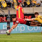 David Havili dives across to score for the Crusaders against the Hurricanes. Photo: Getty