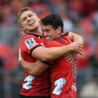 Crusaders youngsters Jack Goodhue (left) and Will Jordan celebrate during their thumping win over...