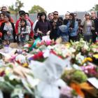 Locals mourn and leave tributes at Deans Rd near the Al Noor mosque. Photo: Getty Images