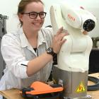 Aspiring electrical engineer Hanri de Bruin poses with an automated arm, similar to the one she...
