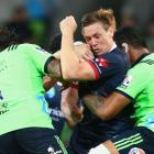 Dane Haylett-Petty of the Rebels is tackled during the round three Super Rugby match between the...