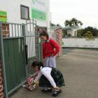 Keilani (11) and Brylee (9) brought flowers to the Invercargill Muslim Community Centre. Photo:...
