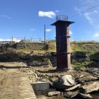 Recently poured concrete piles are in place for the new Sutton Bridge, while the old bridge...