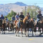 For a few moments, cars gave way as 350 horses and their riders took over the main street of Lake...