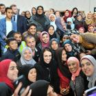 Prime Minister Jacinda Ardern poses for photographs with Dunedin Muslims inside the Al Huda...