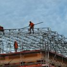 Scaffolders erect a temporary cover over the former ANZ building at the corner of George and St...