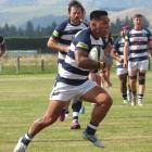 Star midfielder Joe Gillies makes a break in Star's 70-5 win over Riversdale in the opening round...