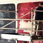 """John Reynolds works on underpainting the """"big wall"""" at the Dunedin Public Art Gallery. Photo: Peter McIntosh"""