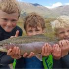 Noah Elder (10), Fletcher Melville (9), and Jordy Elder (6) show off their catch of the day after fishing at Lake Ohau. Photo: Mark Elder