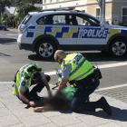 A man was placed into a recovery position by police before he was taken away in a St John...
