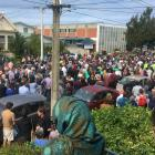 About 1000 people gathered outside the Al Huda mosque in Dunedin. Photo: Stephen Jaquiery
