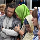 Supporters mourn outside the Al Huda mosque yesterday. PHOTOS: STEPHEN JAQUIERY