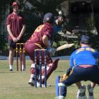 North East Valley batsman Llew Johnson prepares to play a delivery from University-Grange bowler...