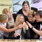 Ex-Cadbury employee Megan Fairley prepares to eat some Ocho chocolate surrounded by former...