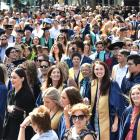 Otago Polytechnic graduands parade down George St yesterday before their graduation ceremony at...