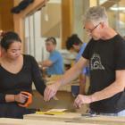 Otago Polytechnic lecturer Alan Fraser helps construction trade skills carpentry student Susha...